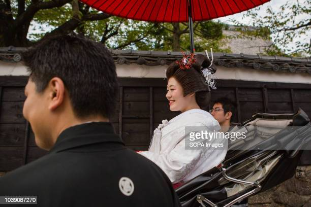 The bride seen riding in a rickshaw during her traditional Japanese style wedding Such wedding are held annually during the Autumn Festival of Gon at...