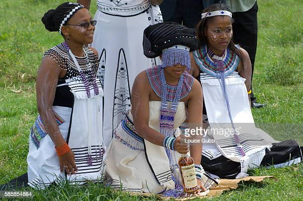 The Bride Tando her eyes masked in beading prepares to perform a traditional ritual of Umkhonto Stabbing a spear in the ground to cement her place in...
