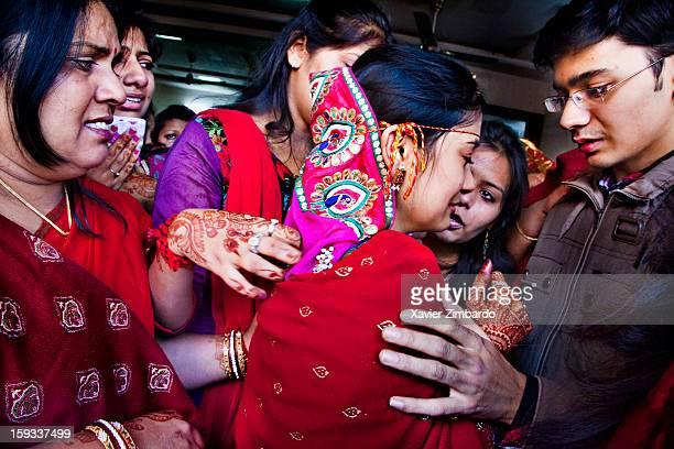 The bride's family members consoling her during the 'vidai' on January 4 2012 at Ostwal House Kushal Nagar in Jodhpur Rajasthan India