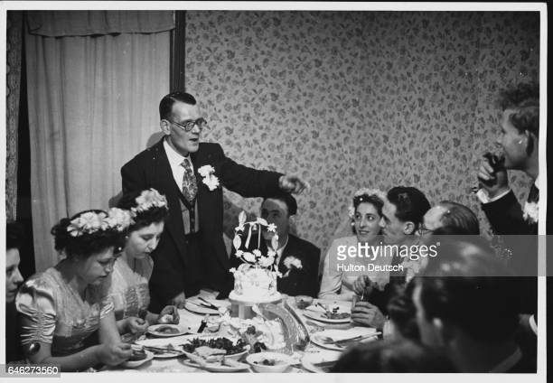 The bride's father rises to make his speech during the meal to celebrate the marriage of Ellen Newman and Alfred Whitbread in Bethnal Green East...