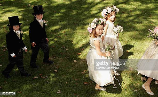 The bridesmaides arrive to the wedding of musician Jools Holland and Christabel McEwen at St James's Church on August 30 2005 in Cooling England The...