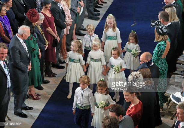 The bridesmaids and page boys arrive for the wedding of Princess Eugenie to Jack Brooksbank at St George's Chapel in Windsor Castle on October 12...