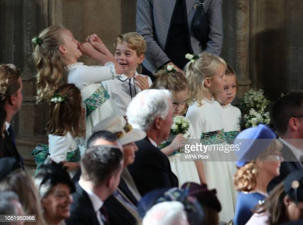 The bridesmaids and page boys inclduing Prince George and Princess Charlotte arrive for the wedding of Princess Eugenie to Jack Brooksbank at St...