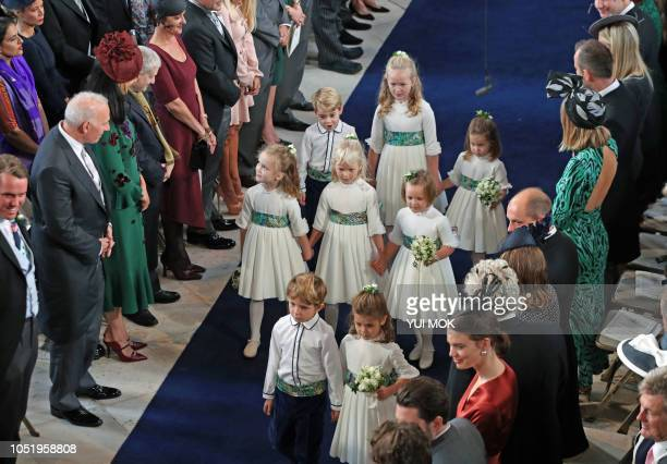 The bridesmaids and page boys including Britain's Prince George and his sister Princess Charlotte attend the wedding ceremony of Britain's Princess...