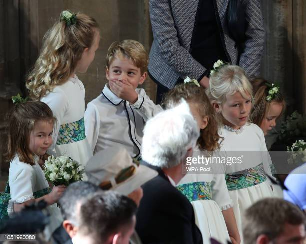 The bridesmaids and page boys including Prince George and Princess Charlotte arrive ahead of the wedding of Princess Eugenie of York and Mr Jack...