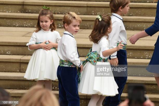 The bridesmaids and page boys including Prince George of Cambridge and Princess Charlotte of Cambridge arrive with Lady Louise MountbattenWindsor for...