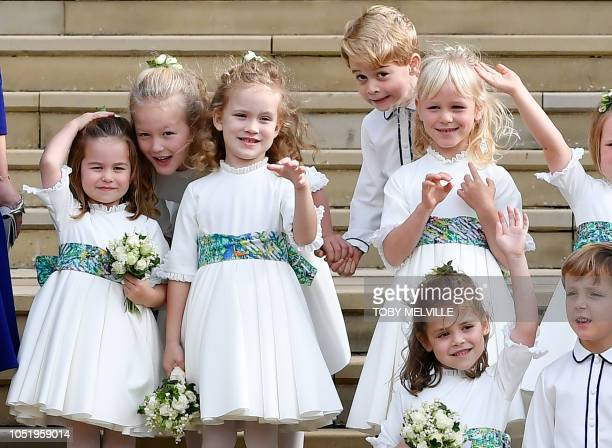 TOPSHOT The bridesmaids and page boys including Prince George of Cambridge and Princess Charlotte of Cambridge wave off Britain's Princess Eugenie of...