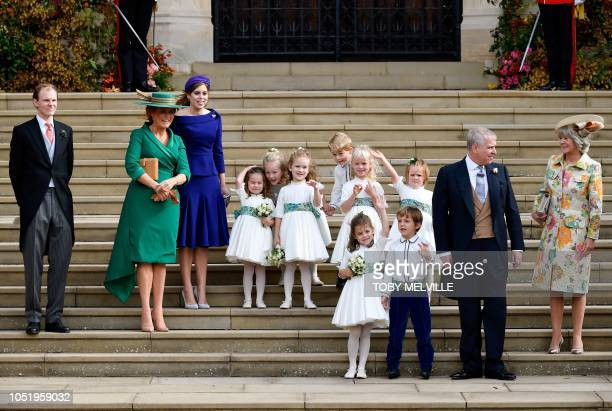 The bridesmaids and page boys, including Prince George of Cambridge and Princess Charlotte of Cambridge , stand with Sarah, Duchess of York ,...