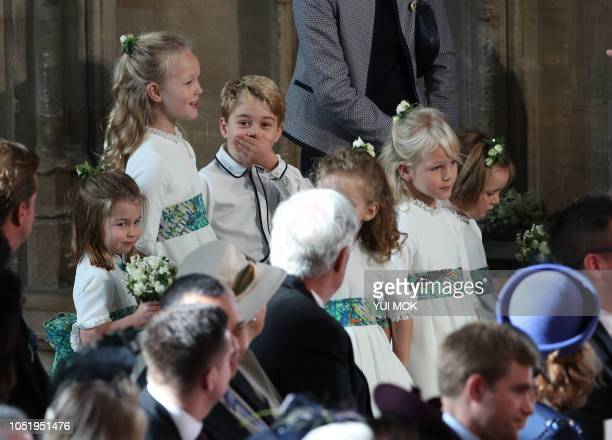 The bridesmaids and page boys including Princess Charlotte of Cambridge Savannah Phillips and Prince George of Cambridge wait to take part in the...