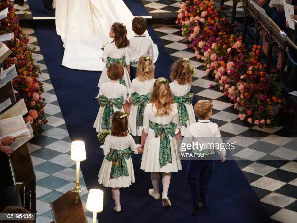 The bridesmaids and pageboys follow Princess Eugenie of York down the aisle during her wedding to Jack Brooksbank at St George's Chapel on October 12...