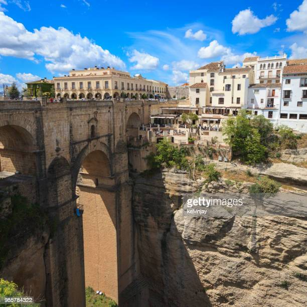 the bridge and gorge in ronda, andalusia, spain. - ronda stock pictures, royalty-free photos & images