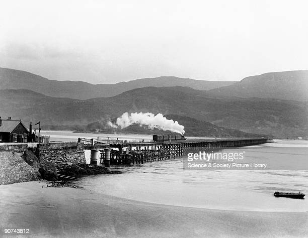 The bridge extends 800 yards across the Mawddach estuary to Pwllheli on 113 timber piers with eight iron spans at the Barmouth end including a...