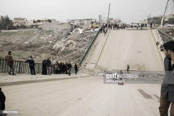 The bridge of Mosul which was destroyed by airstrikes On the right side of bridge you will see that children uses the bridge as a playground slide...