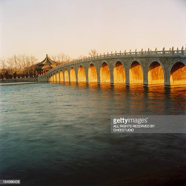 the bridge of Summer Palace in the sunset light