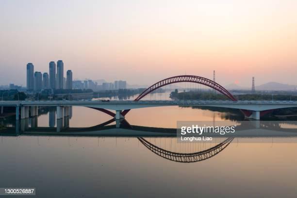 the bridge over the river in the morning - ponte ad arco foto e immagini stock