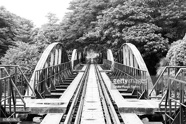 the bridge over the river kwai - thailandia stock photos and pictures