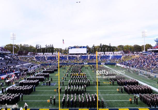 The Brigade of the Midshipmen line up on the field prior to the game against the South Florida Bulls as two F18e Super Hornets fly over on October 19...