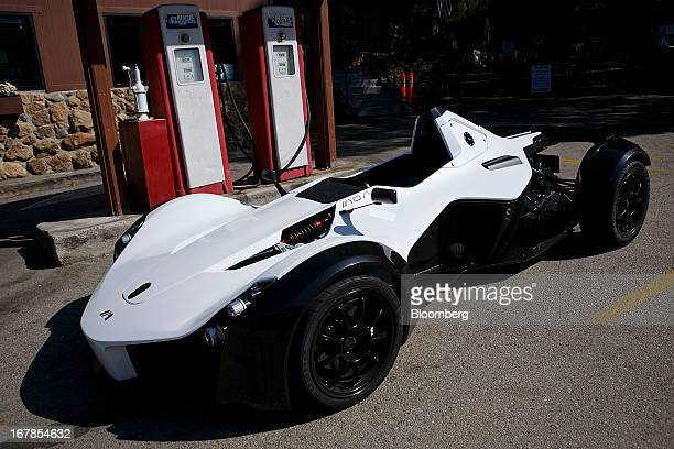 The Briggs Automotive Company Mono Streetlegal Sports Car Sits At A Gas Station During Test