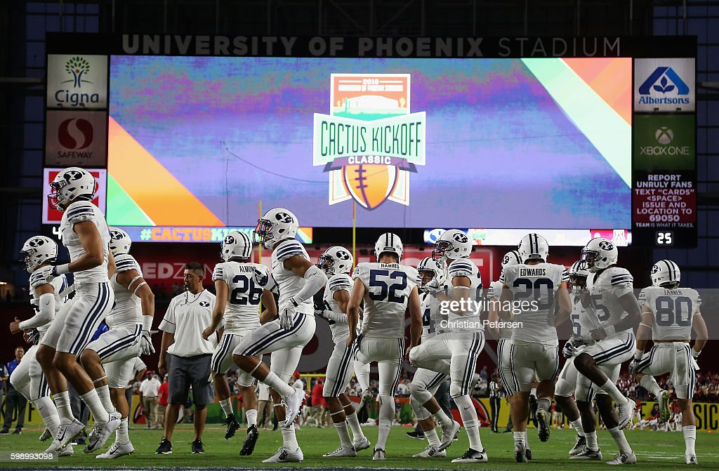 The Brigham Young Cougars warm up before the college football game against the Arizona Wildcats at University of Phoenix Stadium on September 3, 2016 in Glendale, Arizona.