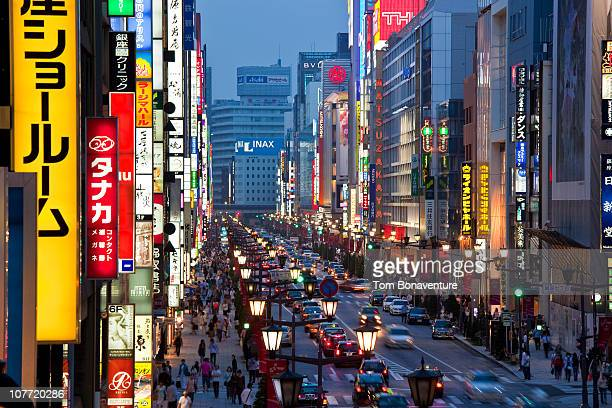 the bright lights of ginza and chuo dori - chuo dori street stock photos and pictures
