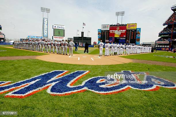 The bright new logo is in place and the Atlanta Braves and the New York Mets are lined up on the field for opening day ceremonies at Shea Stadium The...