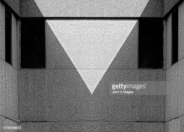 the bright triangle room - triangle shape stock pictures, royalty-free photos & images
