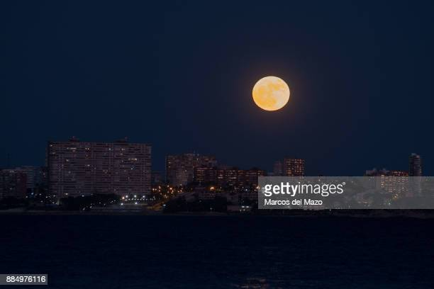 The brightest moon of the year also known as a Super Moon rises over San Juan beach
