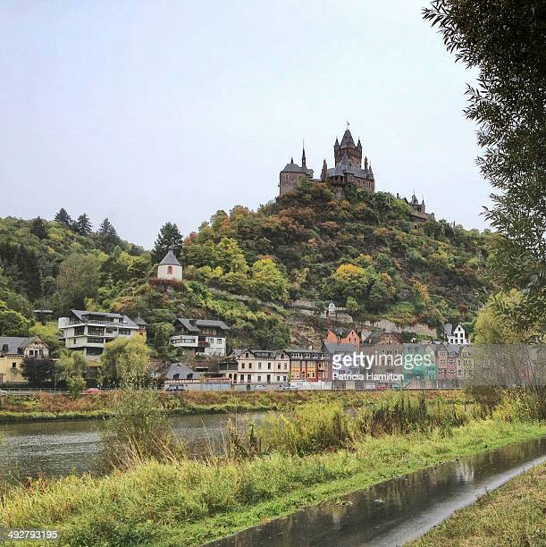 The brightly coloured town of Cochem on the banks of the River Moselle. Cochem Imperial Castle on the hilltop. Square crop.