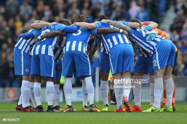 The Brighton and Hove Albion players form a huddle prior to the Premier League match between Brighton and Hove Albion and Southampton at Amex Stadium...