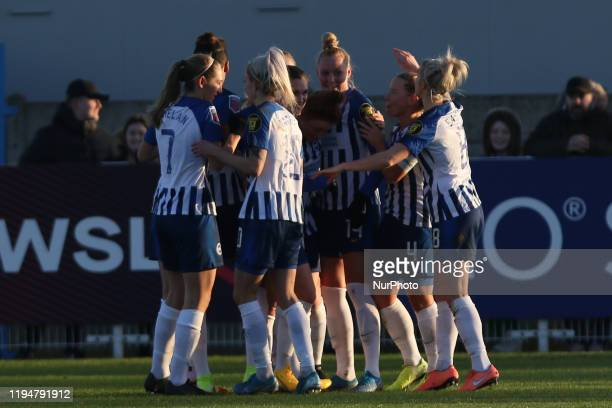 The Brighton team celebrating her team's first goal during the Barclays FA Women's Super League match between West Ham United and Brighton and Hove...
