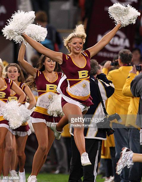 The Brisbane Broncos cheerleaders enter the field before the round 17 NRL match between the Brisbane Broncos and the Cronulla Sharks at Suncorp...
