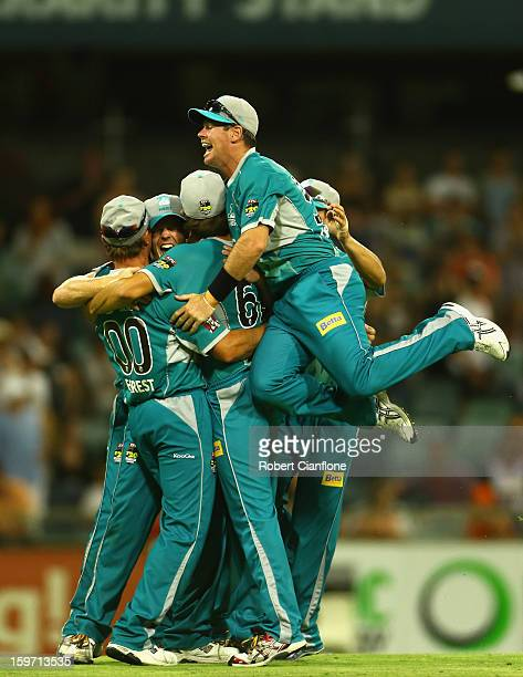 The Brisbane Heat celebrate after they defeated the Scorchers in the Big Bash League final match between the Perth Scorchers and the Brisbane Heat at...