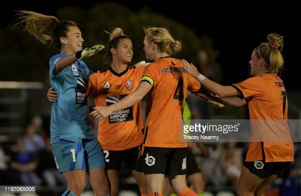 The Brisbane Roar celebrate their win after the round four W-League match between Canberra United and the Brisbane Roar at McKellar Park on December...