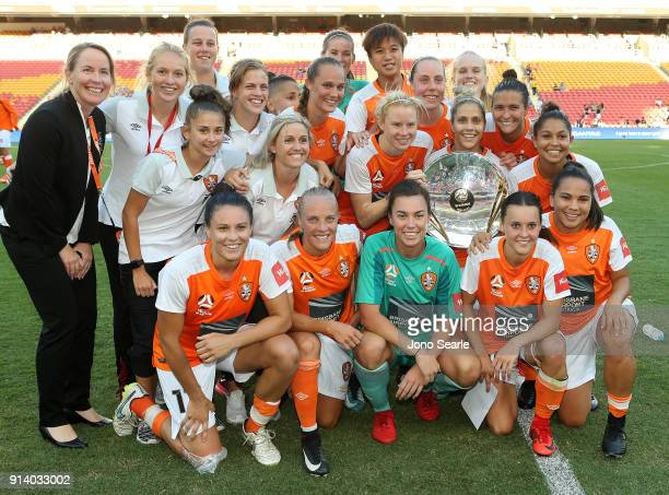 The Brisbane team celebrate winning the minor Premiership after the win during the round 14 WLeague match between the Brisbane Roar and Canberra...