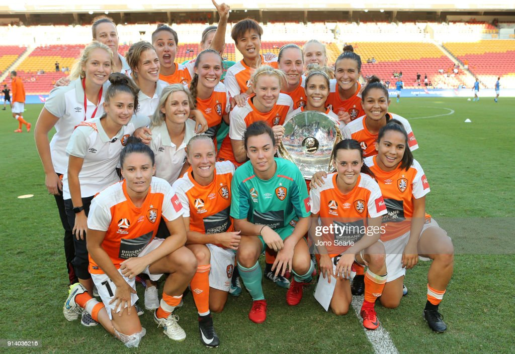 The Brisbane team celebrate winning the minor Premiership after the win during the round 14 W-League match between the Brisbane Roar and Canberra United at Suncorp Stadium on February 4, 2018 in Brisbane, Australia.