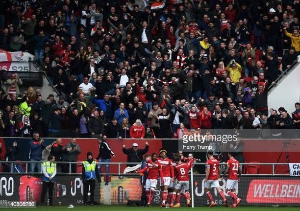 The Bristol City fans celebrate as Kasey Palmer of Bristol City celebrates his sides second goal during the Sky Bet Championship match between...