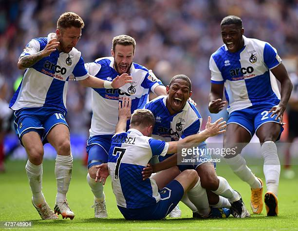 The Bristol Rovers players run to celebrate with Lee Mansell of Bristol Rovers after he scores the winning penalty in the shoot out during the...