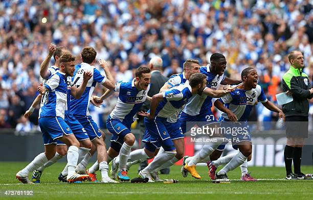 The Bristol Rovers team celebrate as Lee Mansell of Bristol Rovers scores his penalty to secure victory during the Vanarama Conference Playoff Final...