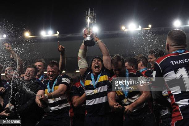 The Bristol Rugby side celebrate with the trophy after the final whistle during the Greene King IPA Championship match between Bristol Rugby and...