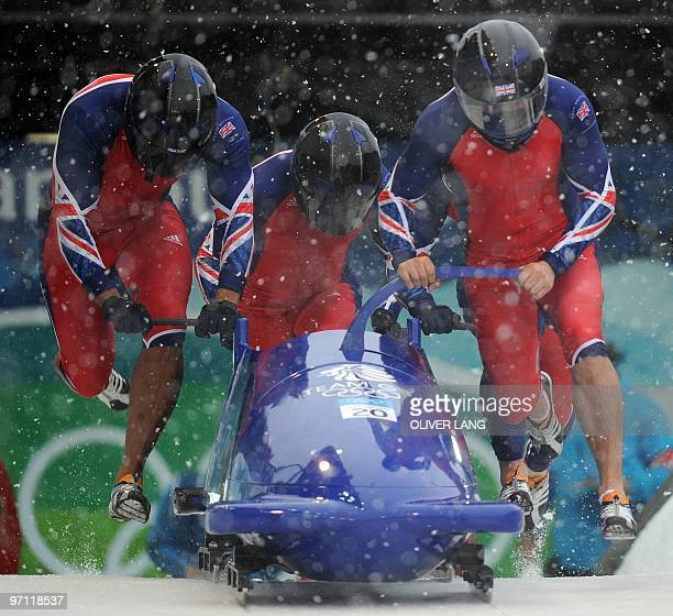 The Britain1 fourman bobsleigh team piloted by John Jackson starts heat 2 at the Whistler sliding centre during the Vancouver Winter Olympics on...