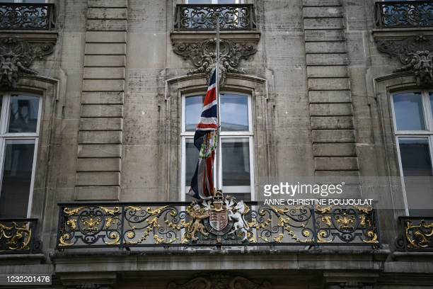 The Britain's national flag, the Union Jack, flies at half-mast, outside the British Embassy, in Paris, on April 9, 2021 after the announcement of...