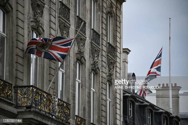 The Britain's national flags, the Union Jack, fly at half-mast, outside the British Embassy, in Paris, on April 9, 2021 after the announcement of the...