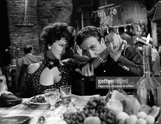 The British actor Peter Sellers and the Italian actress Maria Grazia Buccella in a scene of the film directed by Vittorio De Sica titled After the...
