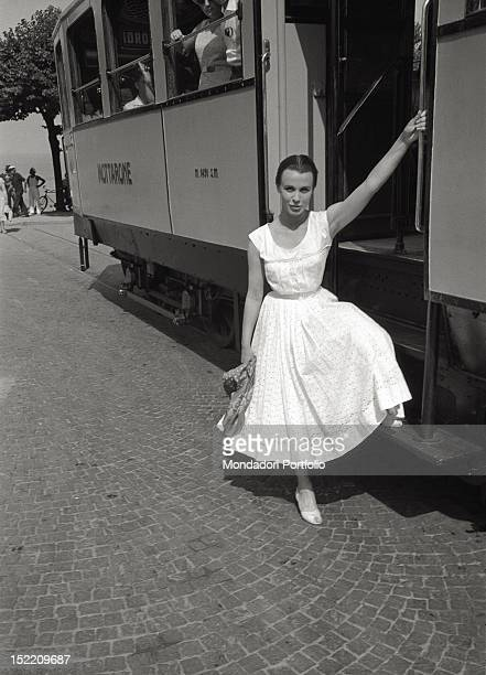 The British actress Claire Bloom is getting on a tram Stresa August 1956