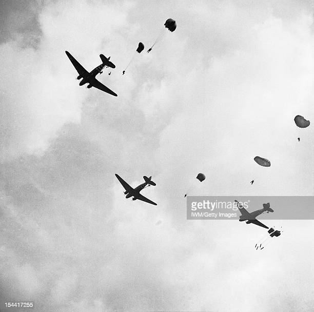 The British Airborne Division At Arnhem And Oosterbeek In Holland Paratroops drop from Dakota aircraft over the outskirts of Arnhem 17 September 1944