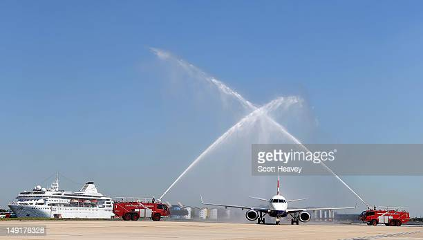 The British Airways plane carrying the British Swimming team is welcomed by a water salute at London City Airport on July 24 2012 in London England