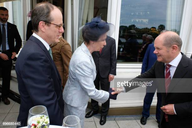 The British ambassador in Germany Sir Sebastian Wood and Princess Anne with mayor Olaf Scholz attend a birthday party for Queen Elizabeth II June 15...