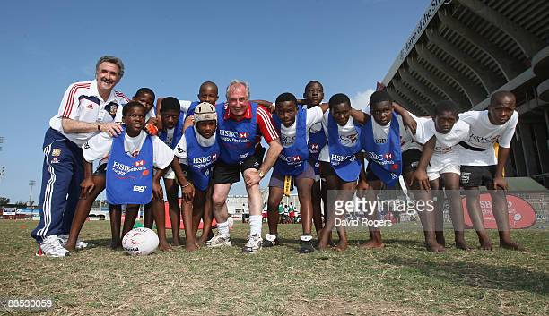 The British and Irish Lions manager Gerald Davies scrums down with former Wales and Lions team mate Gareth Edwards and children during the HSBC...