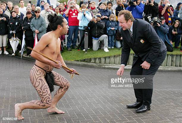 The British and Irish Lions tour manager Bill Beaumont receive a traditional Maori challenge from a Maori warrior as the team is offically welcomed...