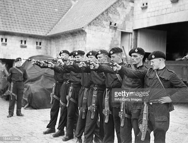 The British Army In France 1939 Men of 4th Royal Tank Regiment practising with their 38 revolvers in a farmyard near Arras 6 October 1939